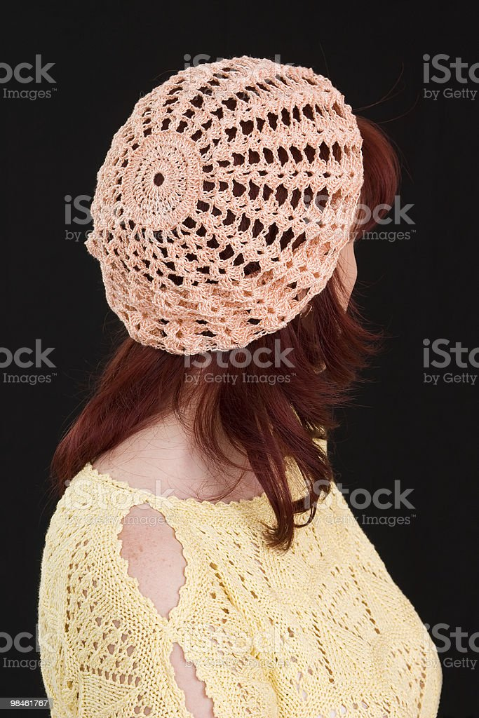 The woman in a peach knitted beret. royalty-free stock photo