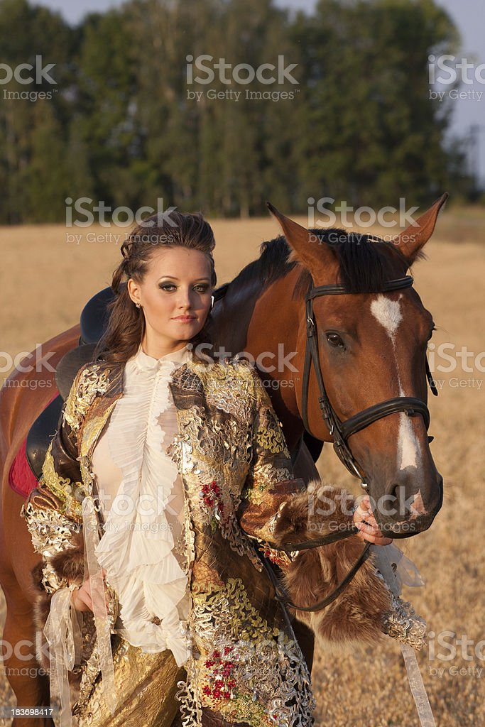 The woman in clothes of 18 centuries with horse stock photo