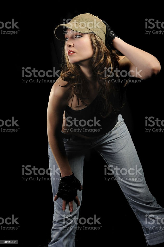 The woman in jeans and a stylish cap royalty-free stock photo