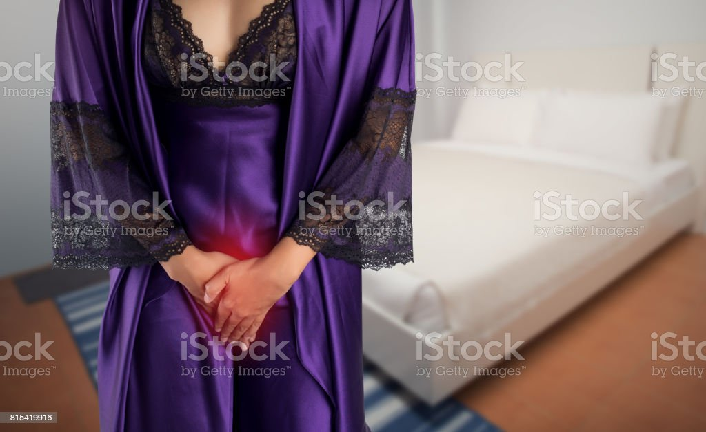 The woman in  purple satin sleepwear and robe wake up for go to restroom. People with urinary bladder problem concept stock photo