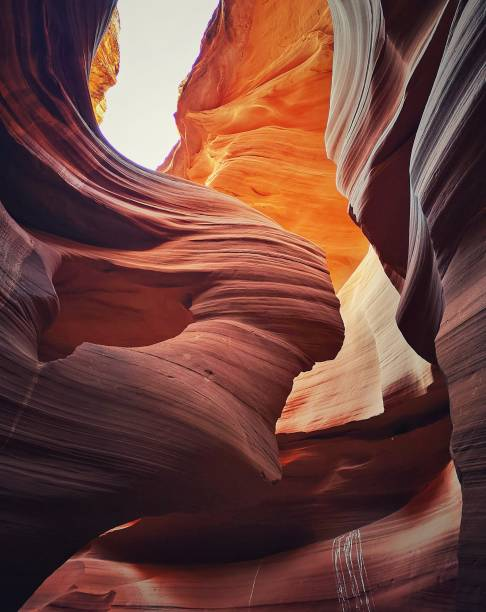 the woman in the wind formation, lower antelope canyon, page, arizona. usa - lower antelope canyon stock photos and pictures