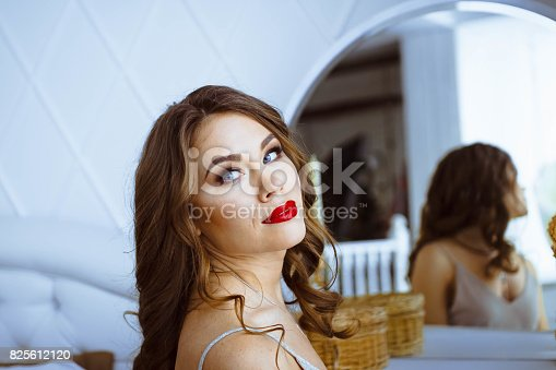 istock The woman is sitting in front of the mirror 825612120