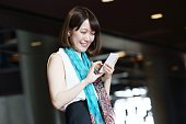The woman office worker who operates a smartphone