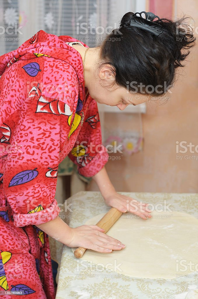 The woman prepares dough royalty-free stock photo