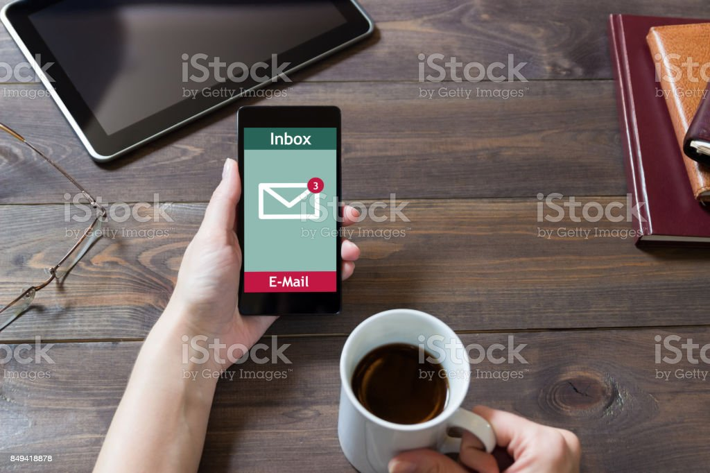 The woman received an email online on a mobile phone. E-mail message icon. stock photo