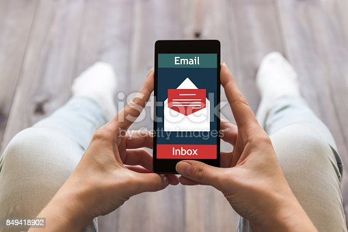 istock The woman received an email online on a mobile phone. E-mail message icon. 849418902