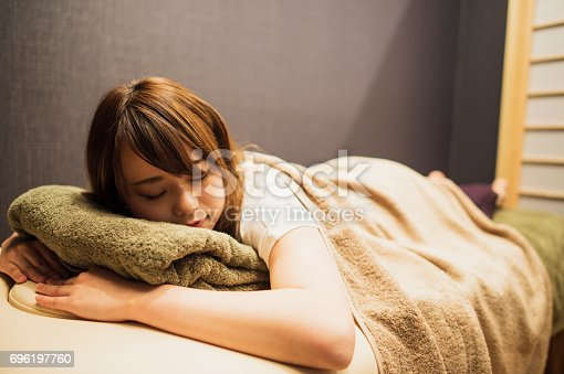 istock The woman receiving a massage and fell asleep. 696197760