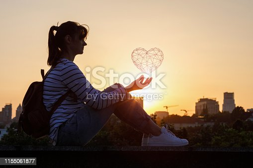 istock The woman shows the geometric model of the heart 1155061877