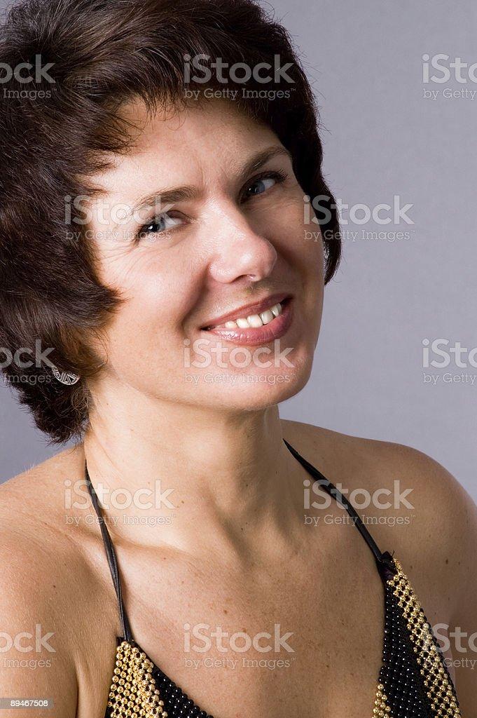 The woman smiles royalty-free stock photo