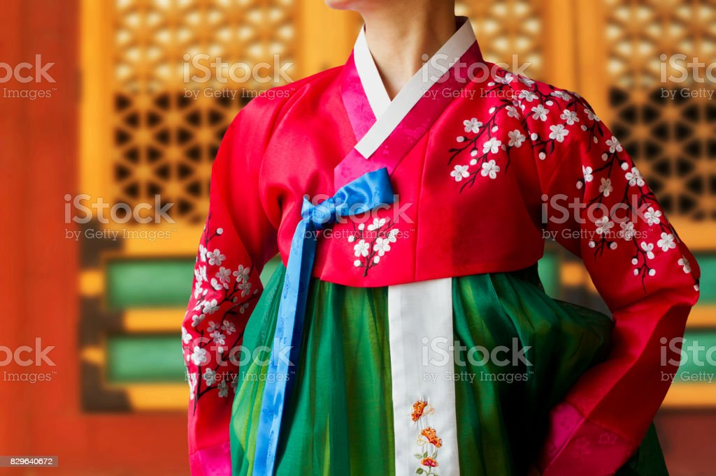 The woman wearing colorful Hanbok, Korean traditional dress in the Deoksugung Palace. stock photo