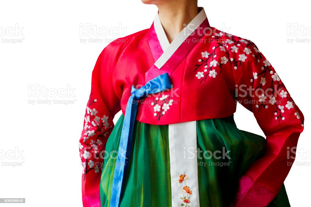 The woman wearing colorful Hanbok, Korean traditional dress isolated on the white background. stock photo