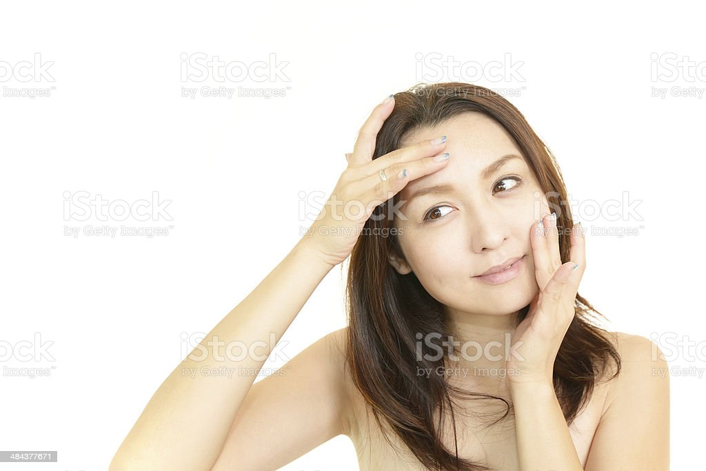 The woman who is doing facial massage stock photo
