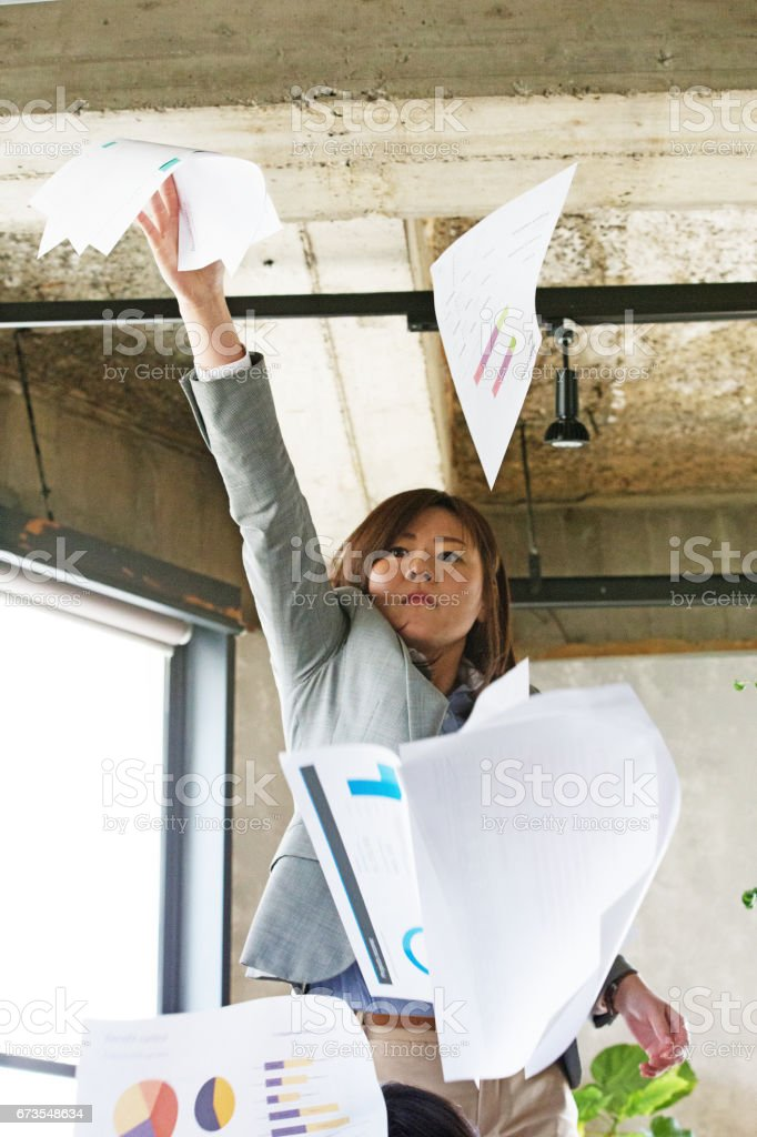 The woman who scatters a document royalty-free stock photo