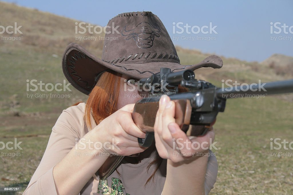 The Woman with rifle royalty-free stock photo