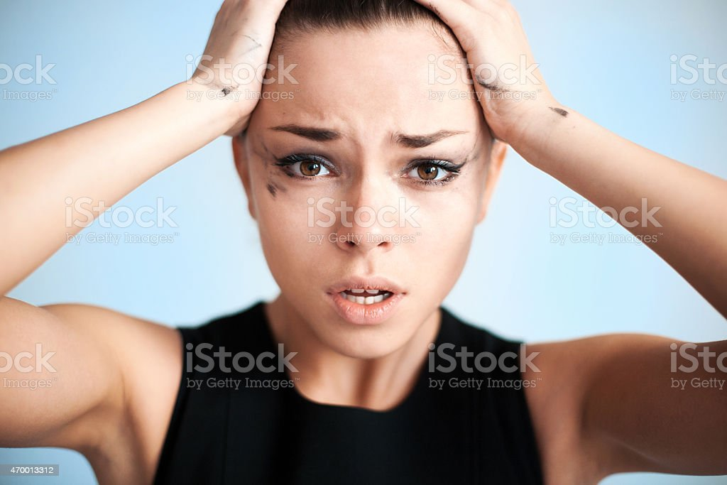The woman with running mascara The woman with the spoiled make-up. 20-24 Years Stock Photo