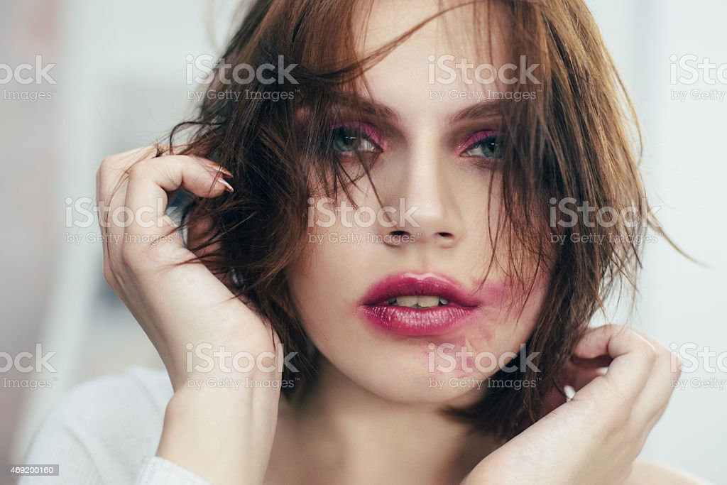 The woman with the smeared lipstick. stock photo
