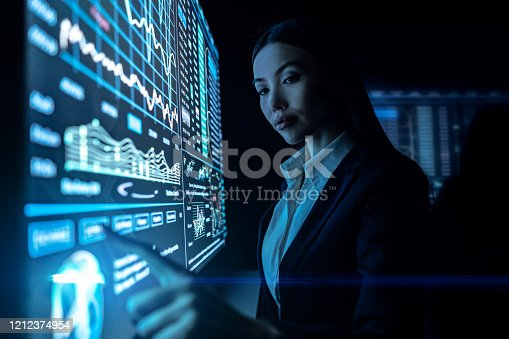 847519080 istock photo The woman works with graphics on a black monitor 1212374954