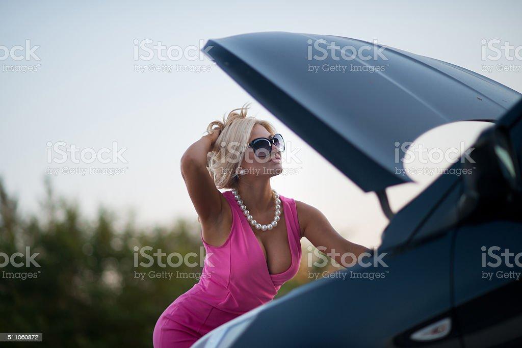 the woman's car broke down stock photo