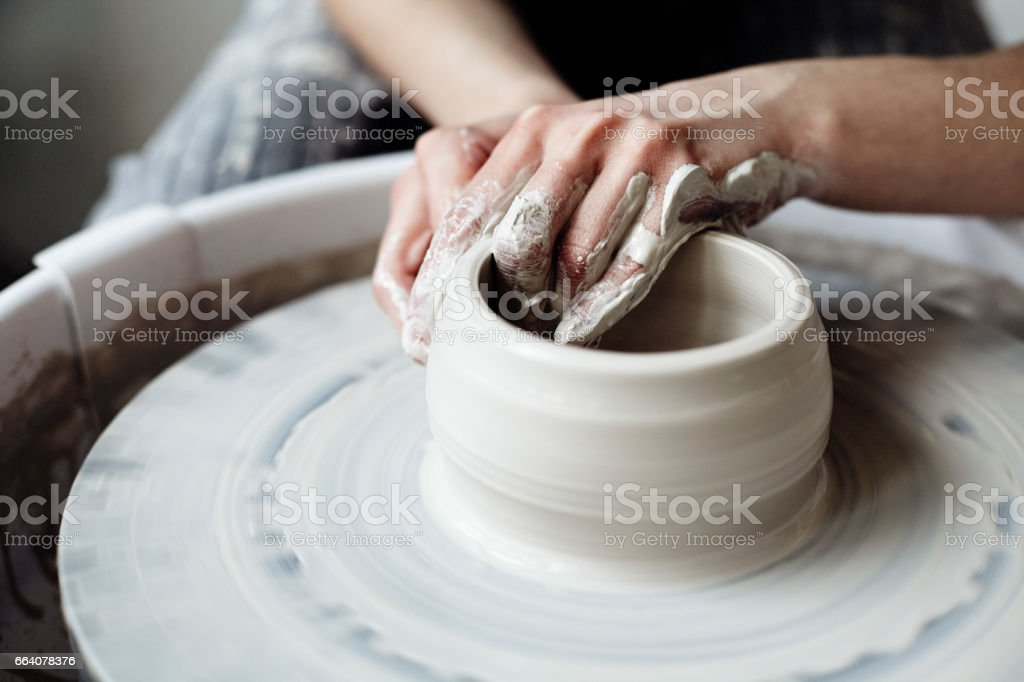 The woman's hands close up, the masterful studio of ceramics works with clay on a potter's wheel stock photo
