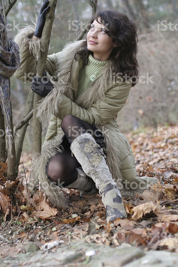 The women in an autumnal park. royaltyfri bildbanksbilder