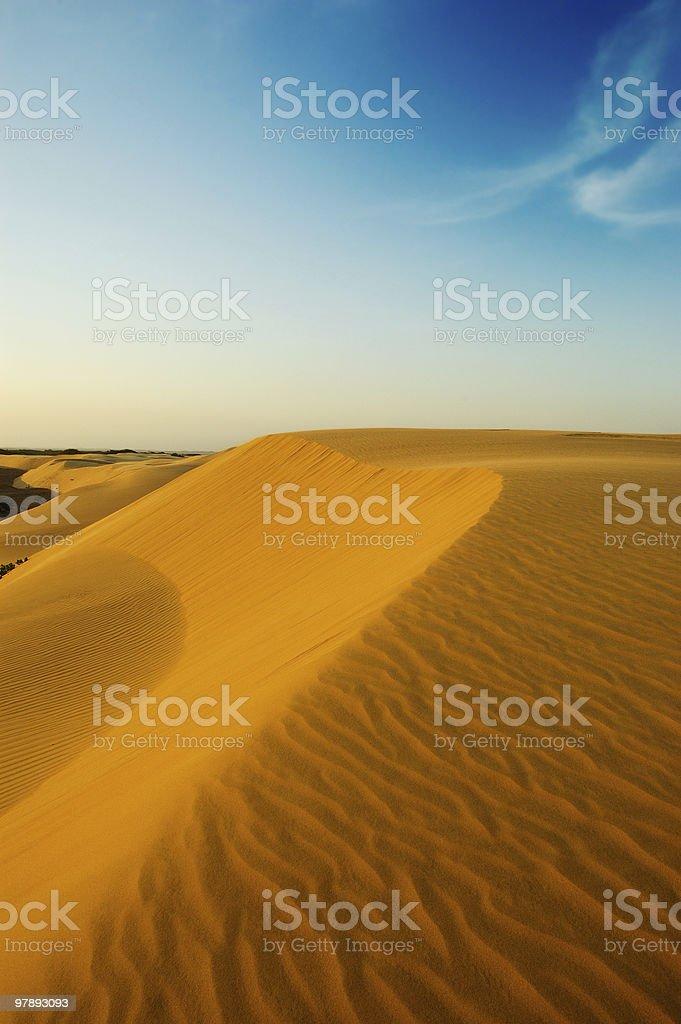 The wonder of lights at dusk on desert sand dunes royalty-free stock photo