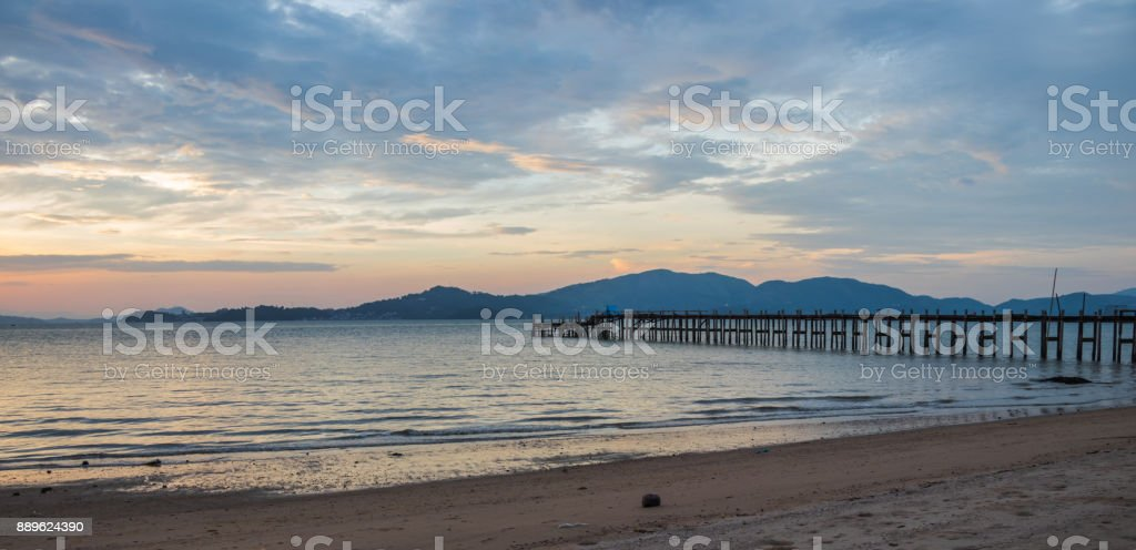 The wood bridge on sunset time in beautiful day in Ranong City stock photo