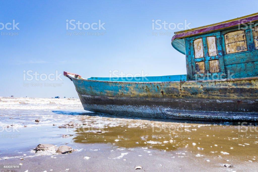 The wood fish ship on beach stock photo
