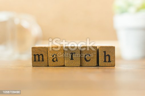 istock The wood stamp month close up image for background. 1058709490