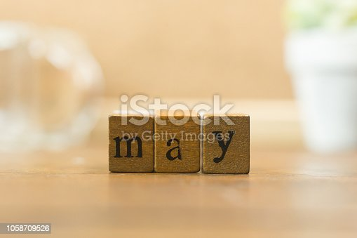 istock The wood stamp month close up image for background. 1058709526
