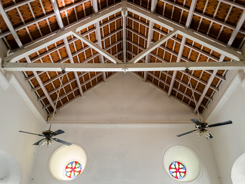 Tharangambadi, Tamil Nadu, India - January 2017: The wooden beams, ceiling and stained glass windows of the ancient New Jerusalem Church in the former Danish colony of Tranquebar.