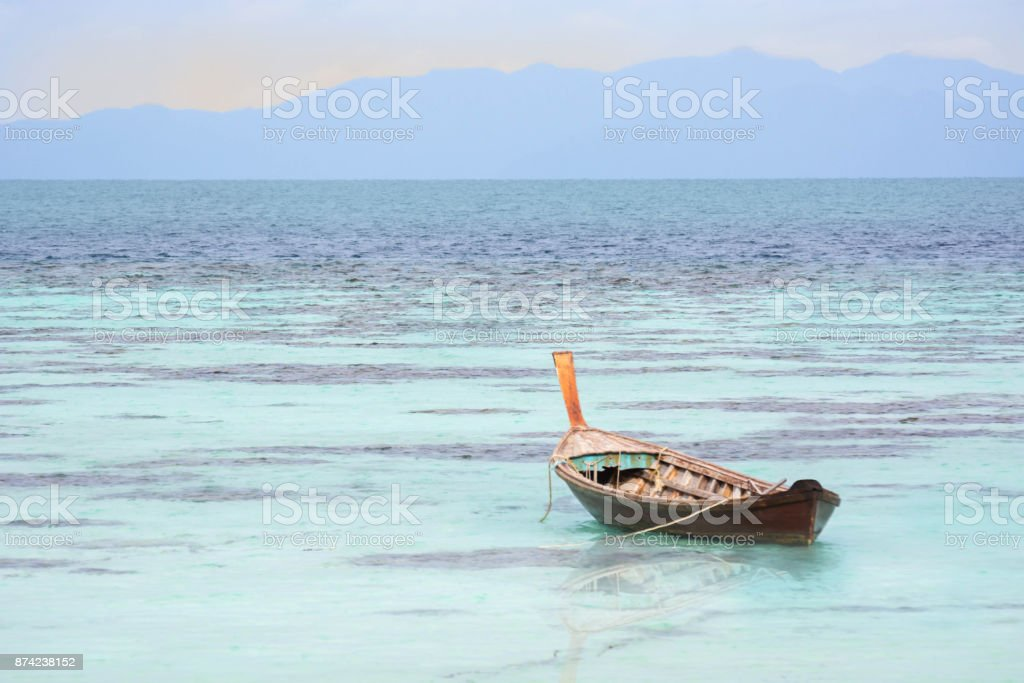 The Wooden Boat On Clear Blue Sea. stock photo