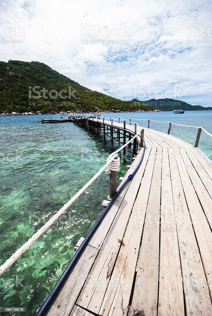The wooden bridge at a beautiful beach royalty-free stock photo