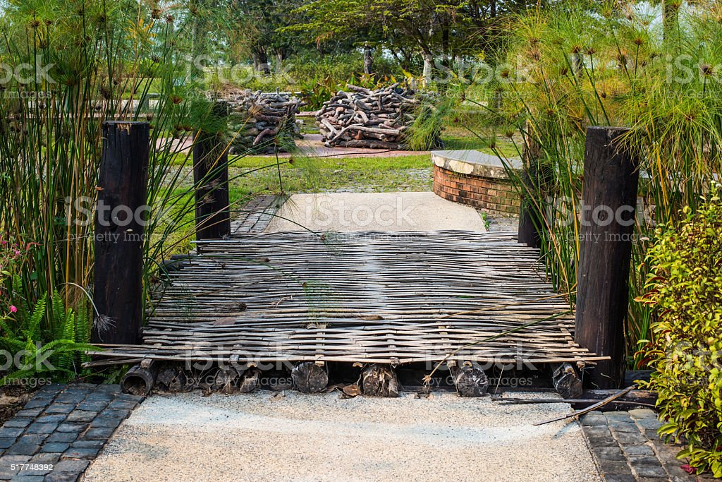 The wooden bridge in the park stock photo