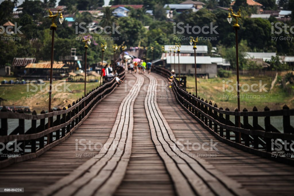 The wooden bridge to village of Sangklaburi, Thailand, selective focus stock photo