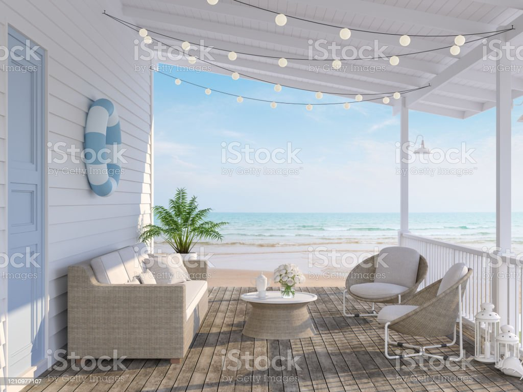 The wooden house terrace on the beach 3d render The wooden house terrace on the beach 3d render,Tthere has old wooden floors,white plank walls,blue doors decorated with fabric and rattan furniture, decorated with string lights, overlooking the sea. Architecture Stock Photo