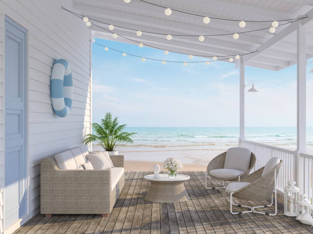 The wooden house terrace on the beach 3d render stock photo