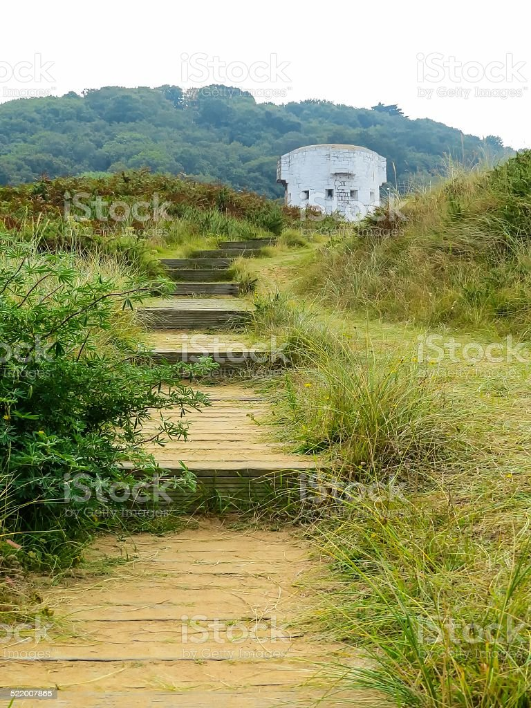 The wooden ladder in dunes of the Jersey island stock photo