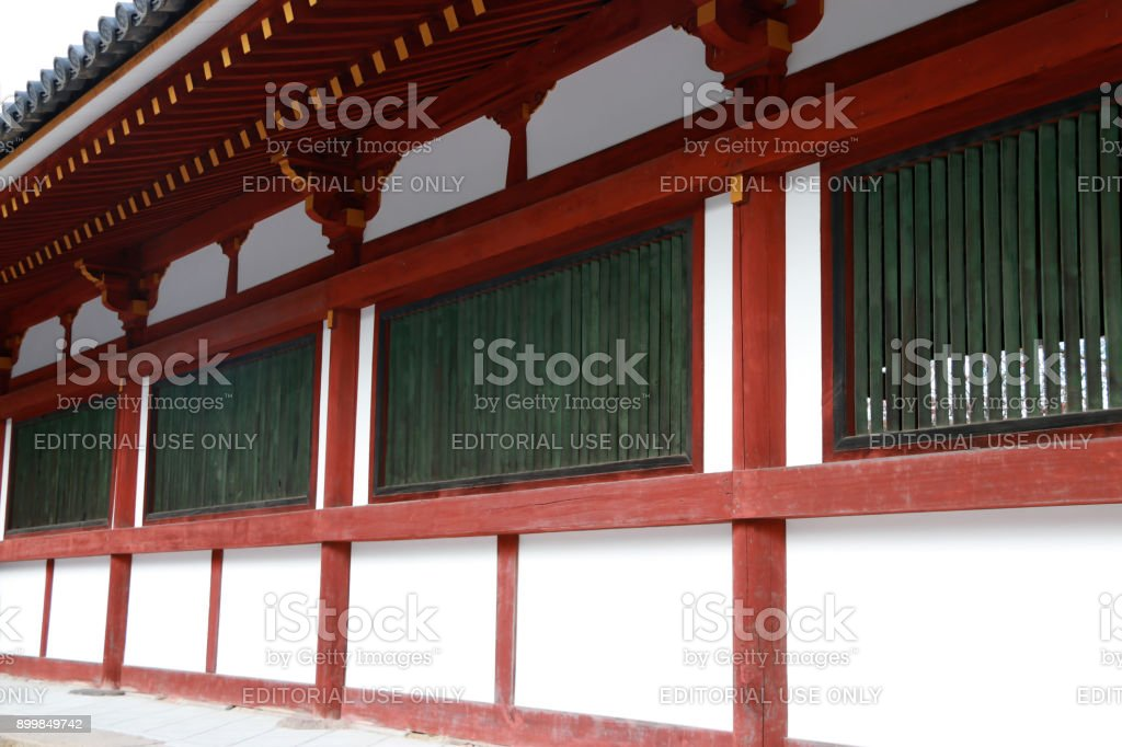 The wooden parapet in red green and white color of second archway entrance at Todaiji temple. stock photo