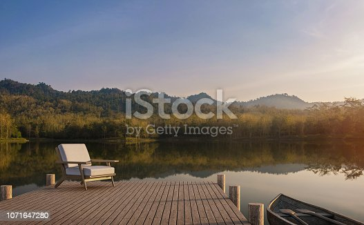 istock The wooden pier looks out to the lake, forest and mountain view 3d render 1071647280