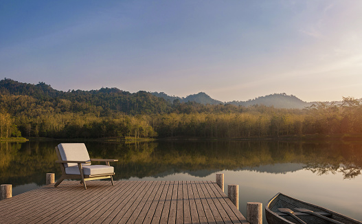 The wooden pier looks out to the lake, forest and mountain view 3d render