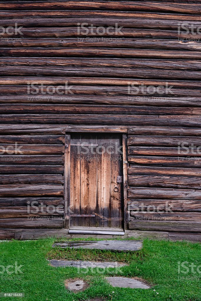 The wooden wall and door. Wood texture or background – zdjęcie