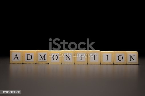 istock The word ADMONITION written on wooden cubes isolated on a black background... 1208809376