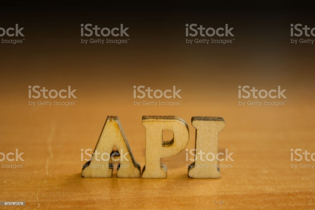 The word 'api' made of wooden letters. stock photo