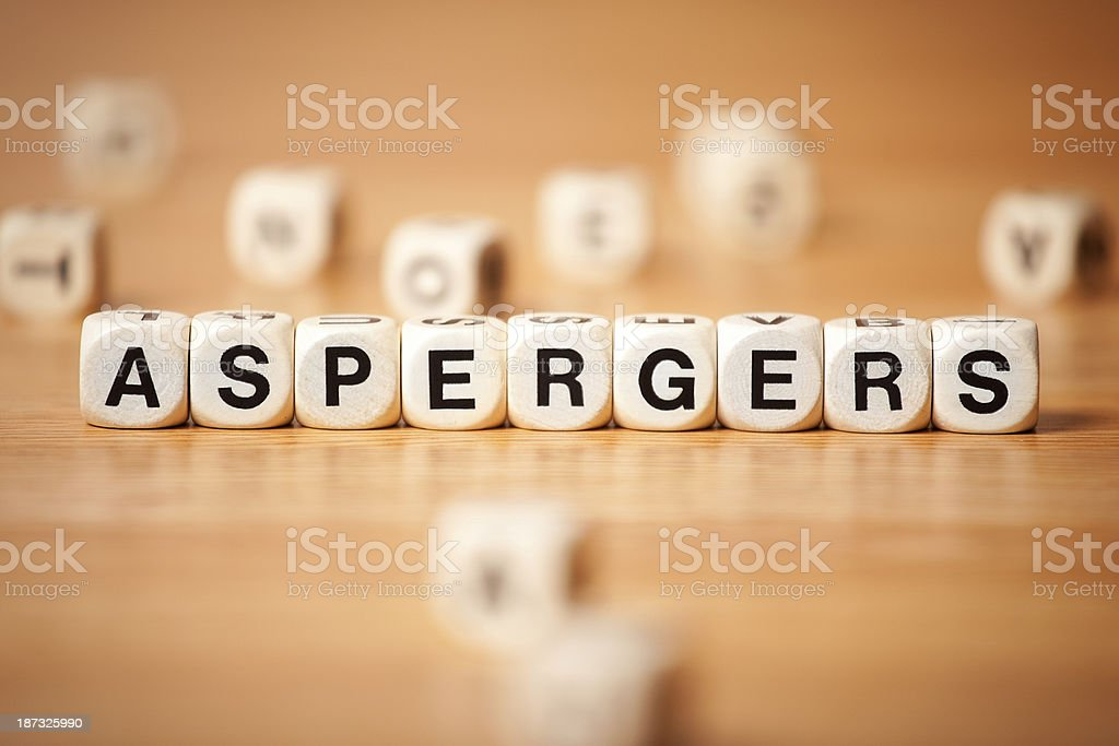 The Word Aspergers Spelled In Letter Cubes stock photo