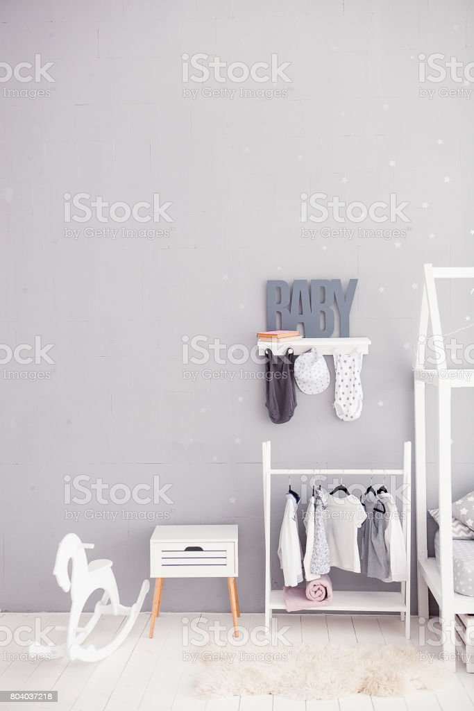 The word baby on a gray background. Inscription toddler. Detail of the interior of the children's room. Children bedroom stock photo