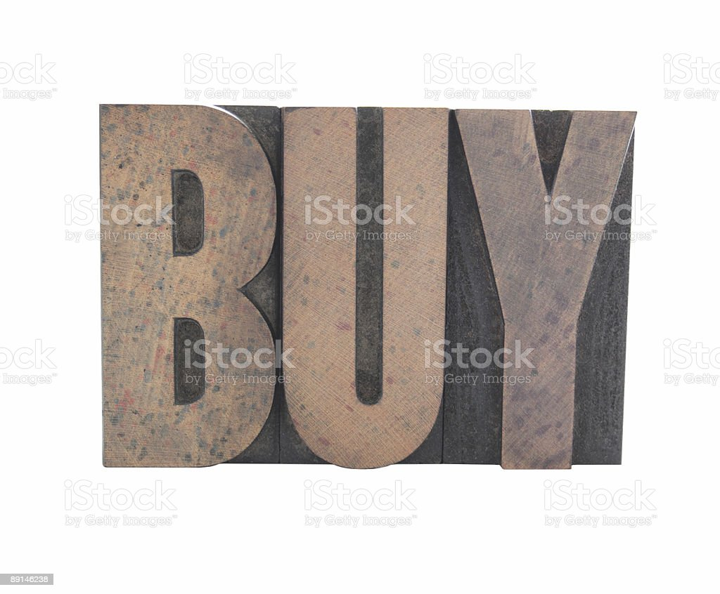 the word 'buy' in old wood letterpress type stock photo