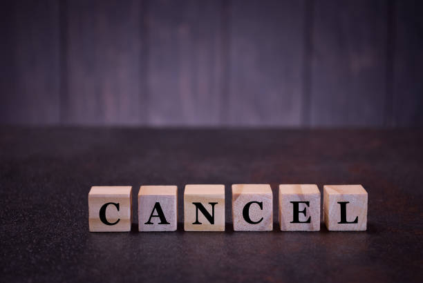 The word cancel on wooden cubes, on a dark background The word cancel on wooden cubes, on a dark background, symbols signs amortize stock pictures, royalty-free photos & images