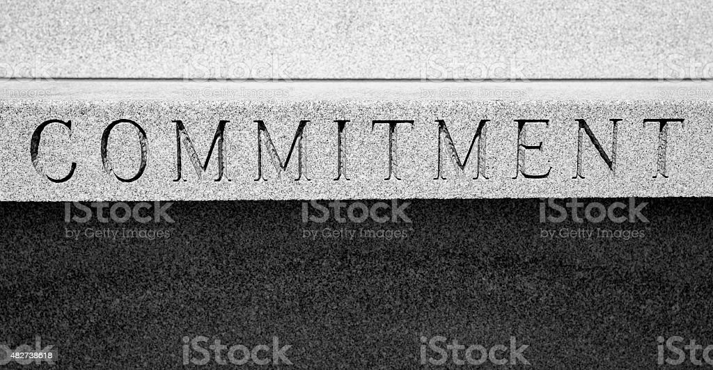 The Word COMMITMENT, Chiseled In Stone, Black and White stock photo