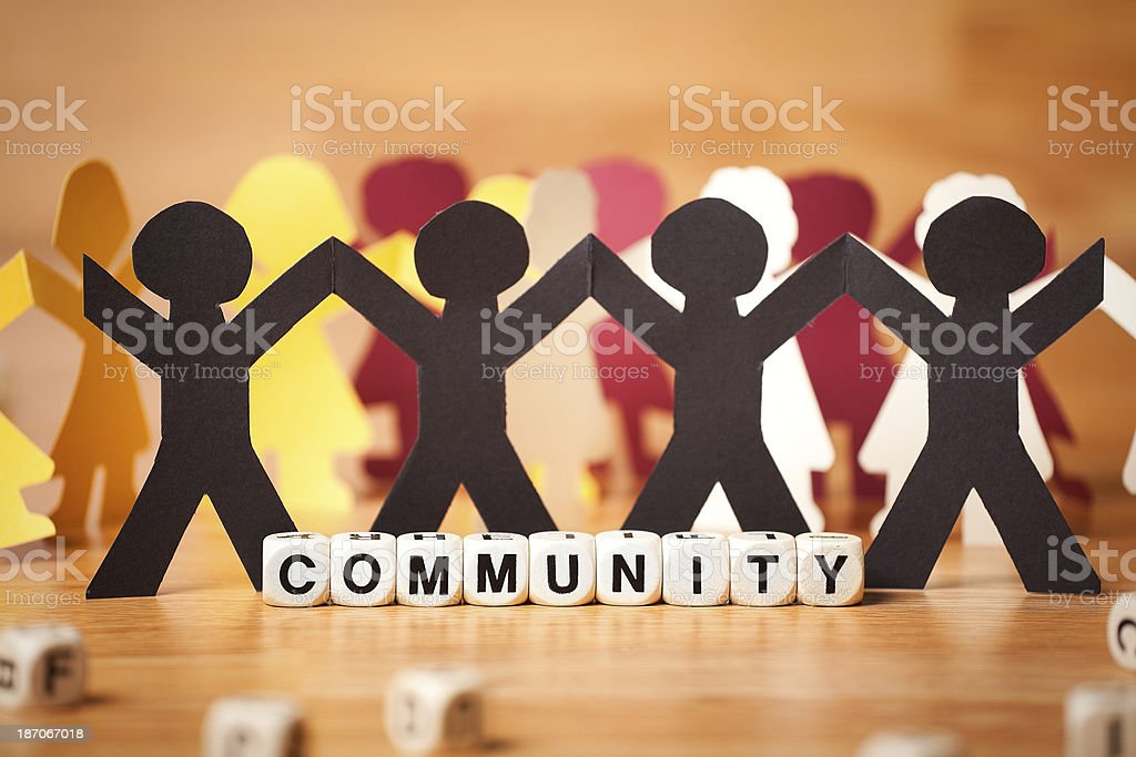 The Word COMMUNITY Spelled In Letter Cubes With Paper People royalty-free stock photo