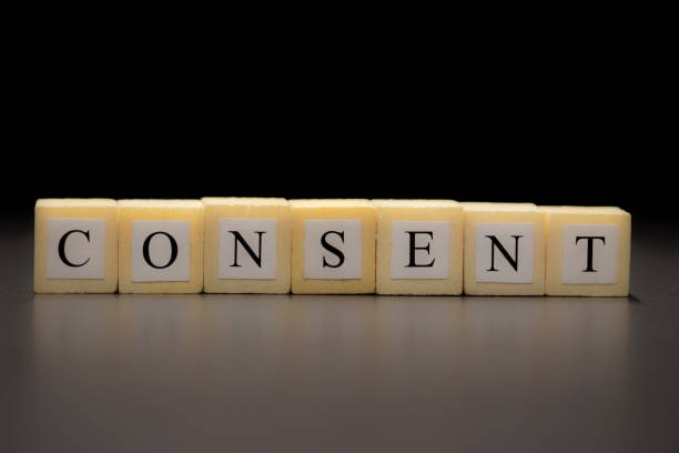 The word CONSENT written on wooden cubes isolated on a black background... The word CONSENT written on wooden cubes isolated on a black background... approbation stock pictures, royalty-free photos & images